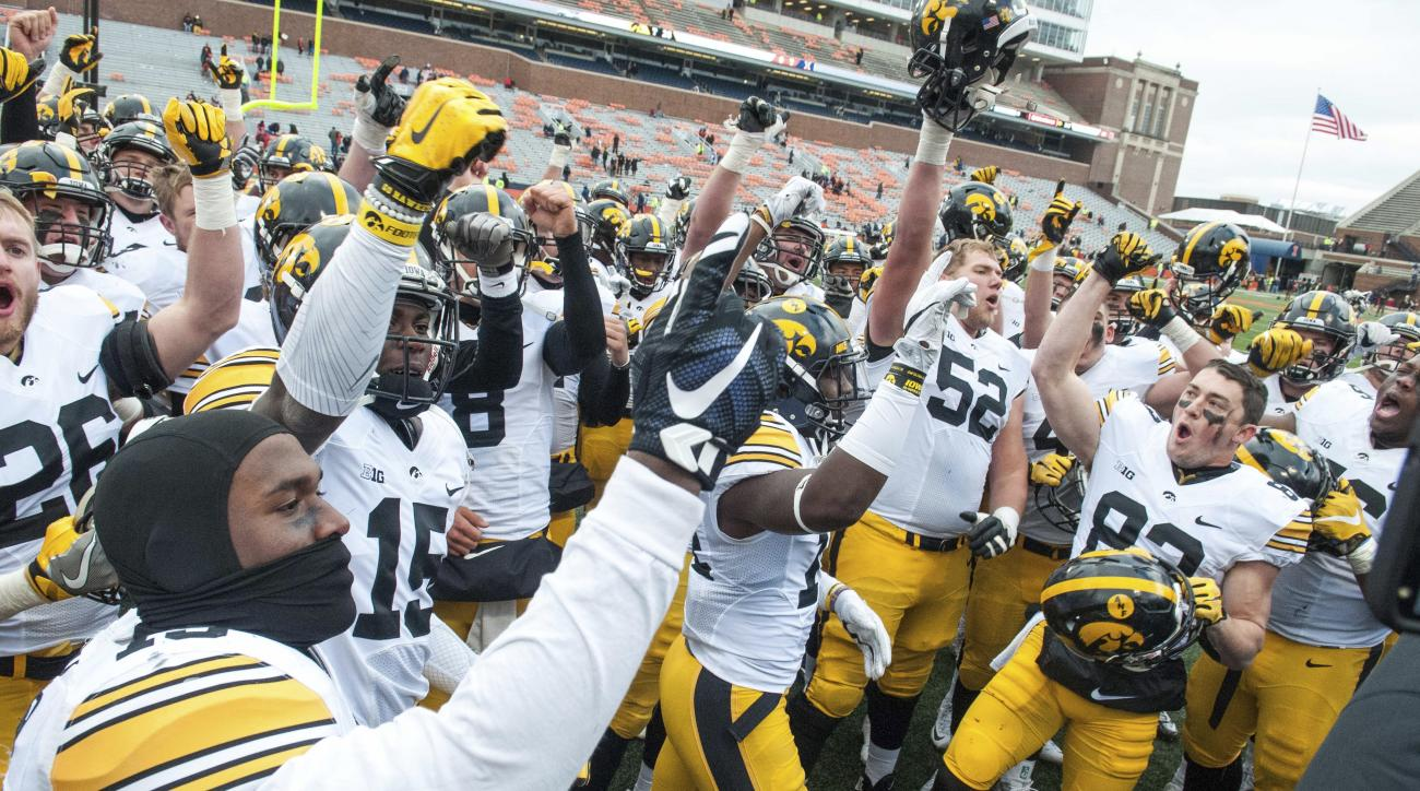 Iowa players celebrate after defeating Illinois 28-0 in an NCAA college football game, Saturday, Nov. 19, 2016 at Memorial Stadium in Champaign, Ill. (AP Photo/Bradley Leeb)