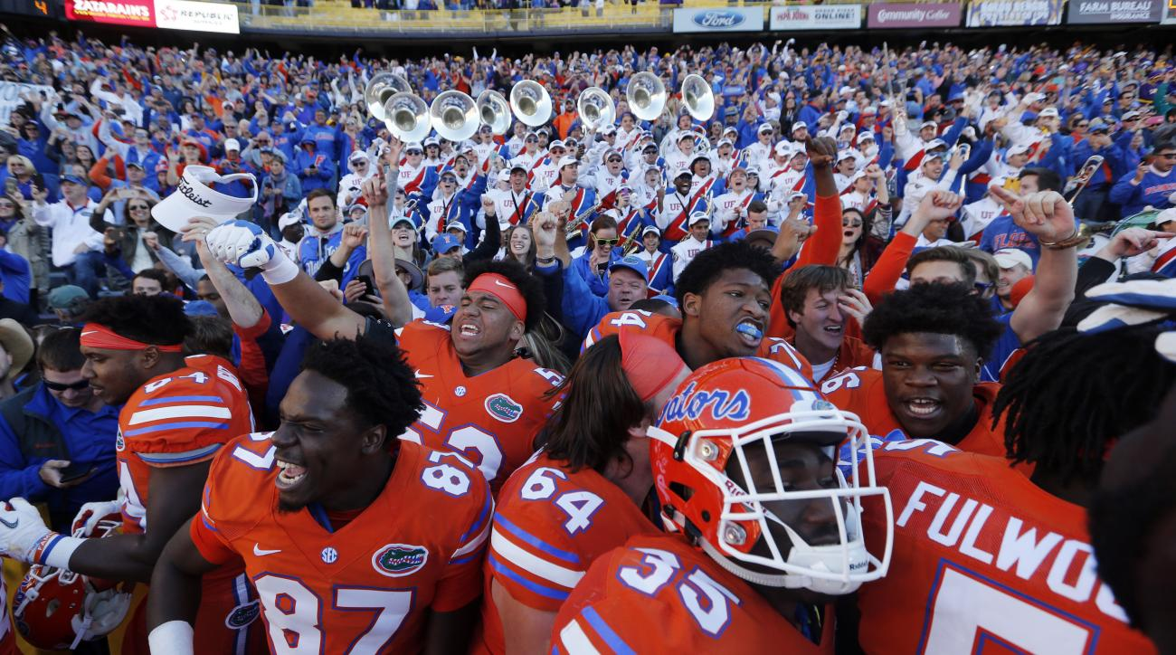 Florida celebrates with fans after defeating LSU in an NCAA college football game in Baton Rouge, La., Saturday, Nov. 19, 2016. Florida won 16-10. (AP Photo/Gerald Herbert)