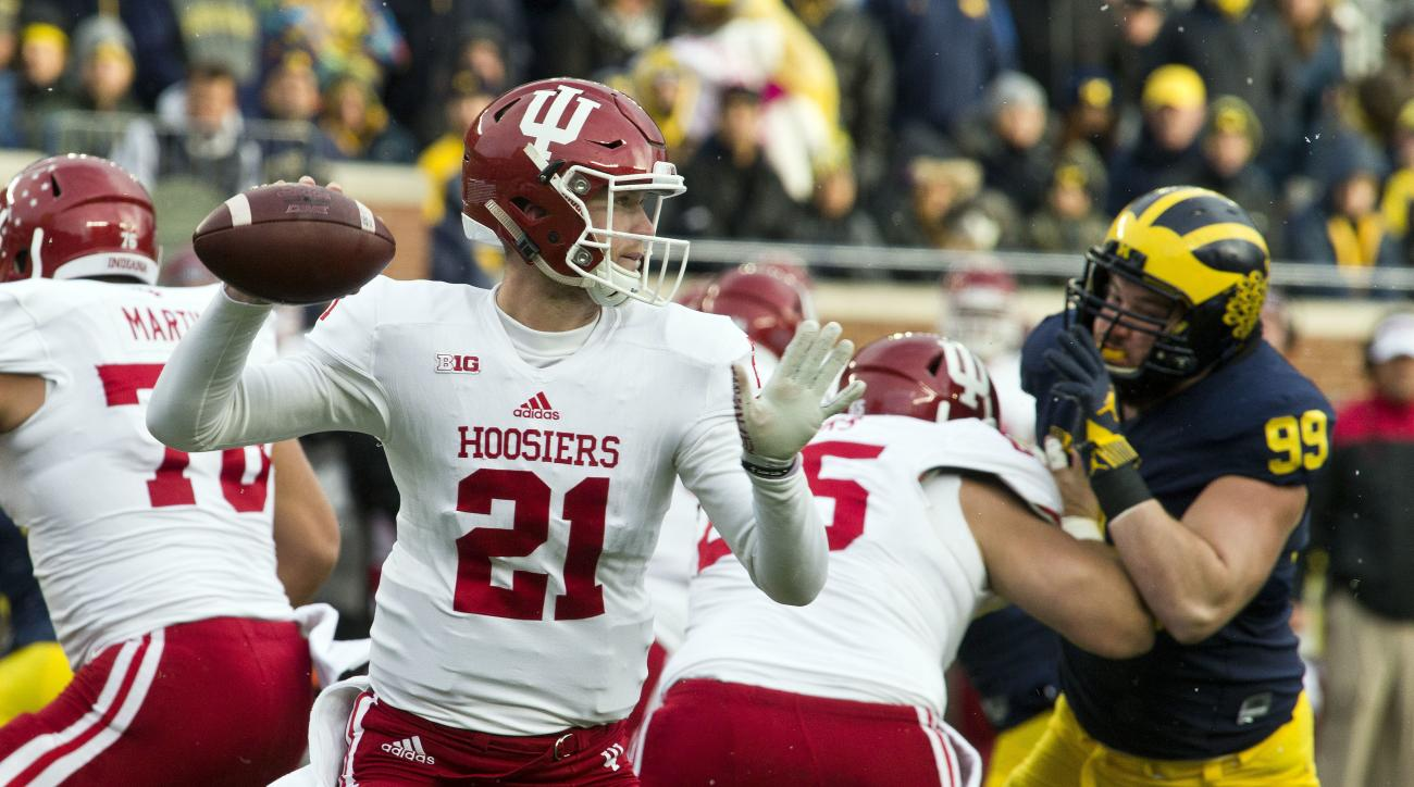 Indiana quarterback Richard Lagow (21) throws a pass in the first quarter of an NCAA college football game against Michigan in Ann Arbor, Mich., Saturday, Nov. 19, 2016. (AP Photo/Tony Ding)