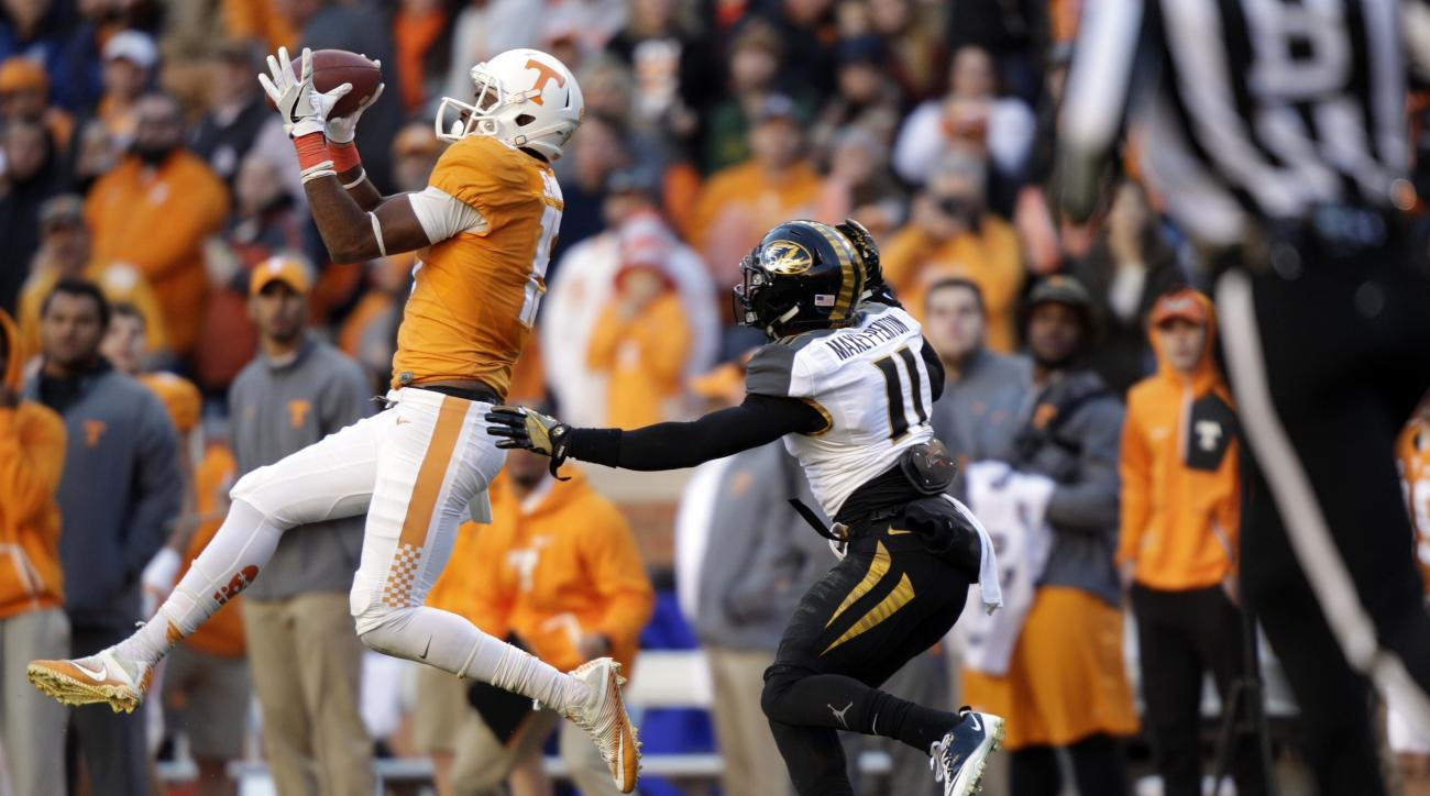 Tennessee wide receiver Jauan Jennings (15) catches a pass as he's defended by Missouri defensive back Aarion Penton (11) during the first half of an NCAA college football game Saturday, Nov. 19, 2016, in Knoxville, Tenn. (AP Photo/Wade Payne)