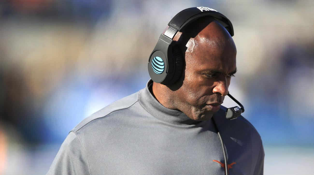 Texas head coach Charlie Strong walks the sideline during the first half of an NCAA college football game against Kansas in Lawrence, Kan., Saturday, Nov. 19, 2016. (AP Photo/Orlin Wagner)