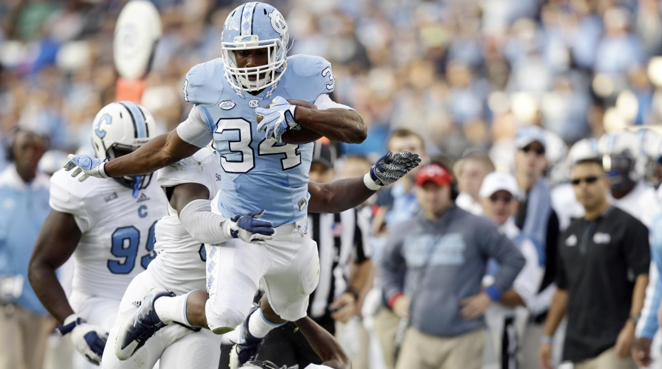 North Carolina's Elijah Hood (34) jumps over The Citadel's Ben Roberts (11) during the first half of an NCAA college football game in Chapel Hill, N.C., Saturday, Nov. 19, 2016. (AP Photo/Gerry Broome)