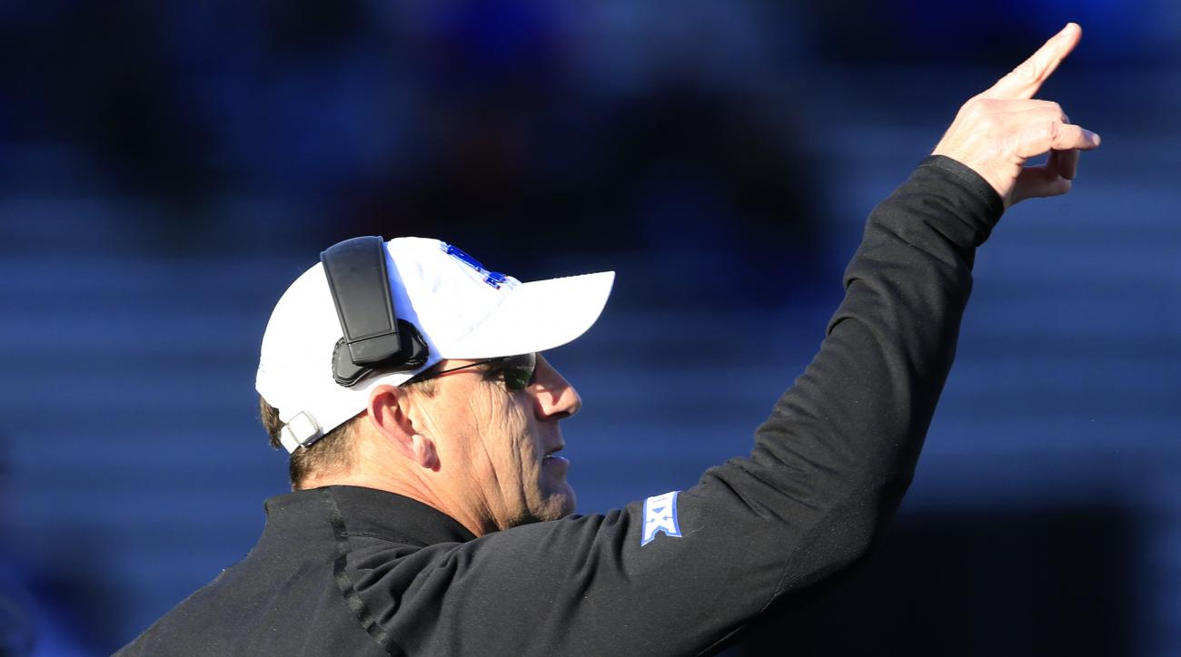Kansas head coach David Beaty directs his team during the first half of an NCAA college football game against Texas in Lawrence, Kan., Saturday, Nov. 19, 2016. (AP Photo/Orlin Wagner)
