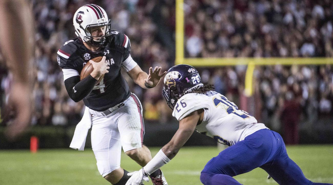 South Carolina quarterback Jake Bentley (4) picks up yardage after a reception during the first half of an NCAA college football game Saturday, Nov. 19, 2016, in Columbia, S.C. (AP Photo/Sean Rayford)