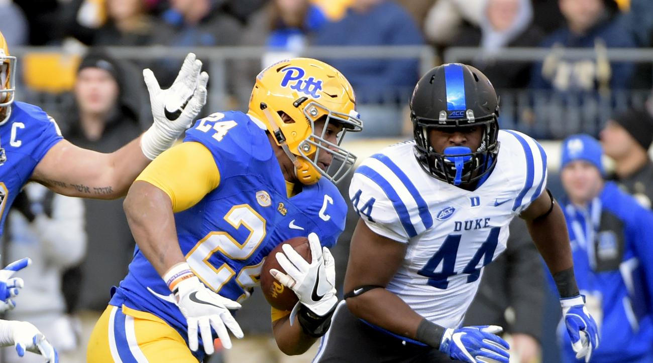 Pittsburgh running back James Conner (24) runs past Duke linebacker Joe Giles-Harris (44) during the first half of an NCAA college football game in Pittsburgh, Saturday, Nov. 19, 2016. (AP Photo/Fred Vuich)