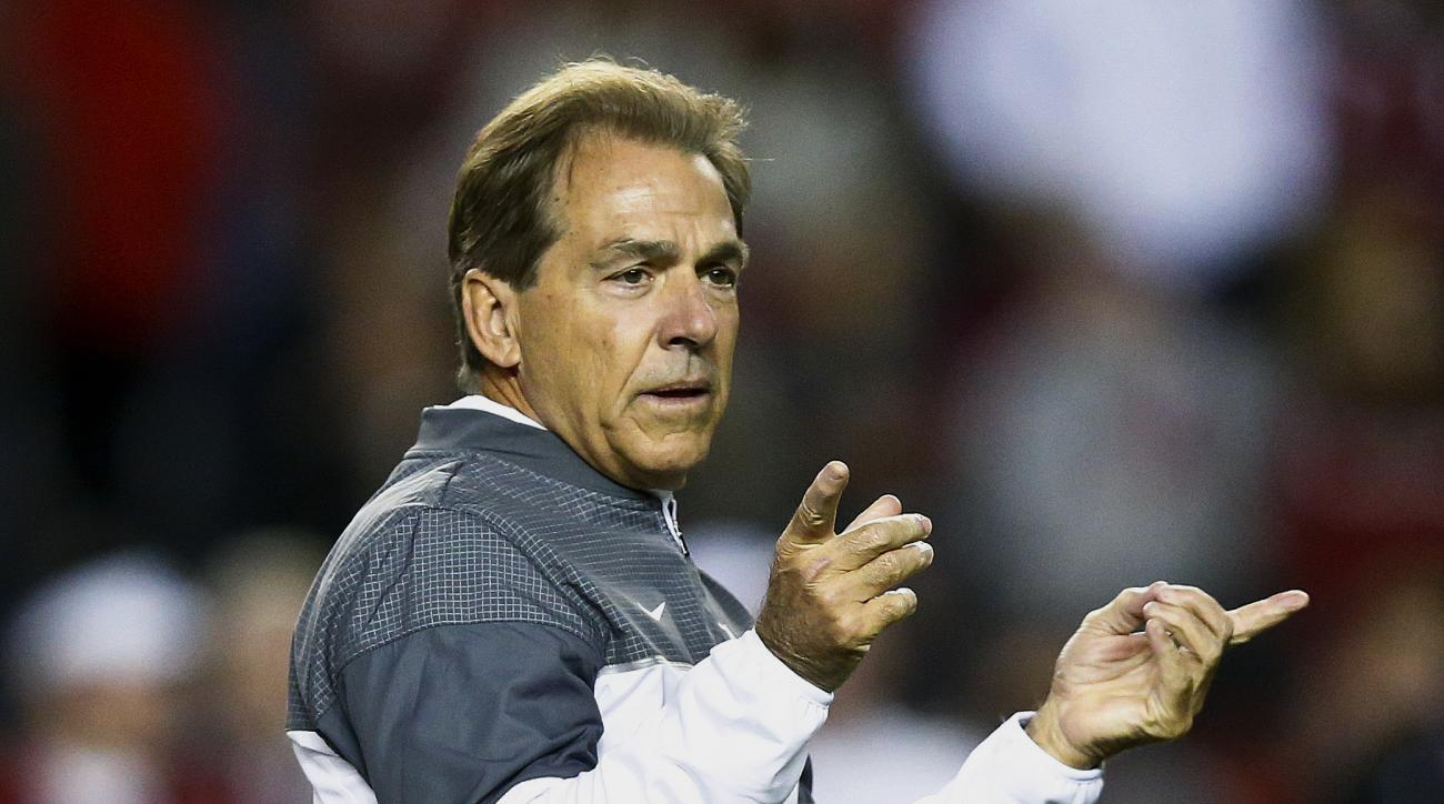 Alabama head coach Nick Saban gestures towards his players before an NCAA college football game against Chattanooga, Saturday, Nov. 19, 2016, in Tuscaloosa, Ala. (AP Photo/Brynn Anderson)