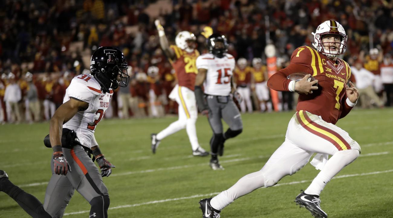 Iowa State quarterback Joel Lanning, right, scores on a 35-yard touchdown run ahead of Texas Tech defensive back Justis Nelson, left, during the second half of an NCAA college football game, Saturday, Nov. 19, 2016, in Ames, Iowa. Iowa State won 66-10. (A
