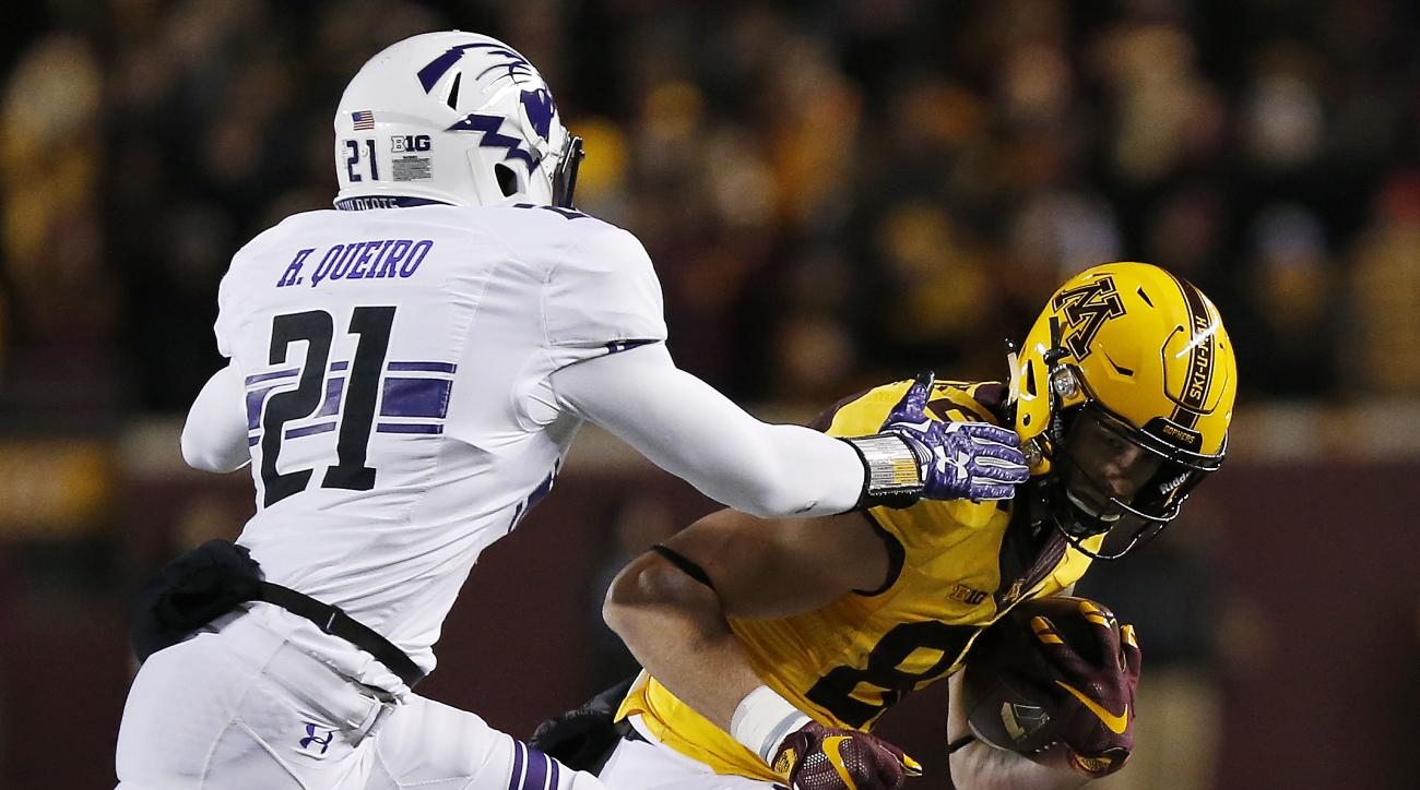Minnesota wide receiver Drew Wolitarsky holds onto the ball against Northwestern safety Kyle Queiro during an NCAA college football game Saturday, Nov. 19, 2016, in Minneapolis. Minnesota won 29-12. (AP Photo/Stacy Bengs)