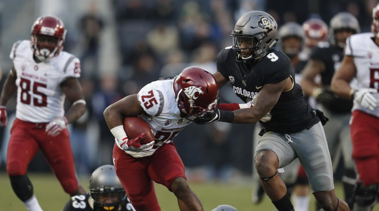 Washington State running back Jamal Morrow, front left, is tackled by Colorado defensive back Tedric Thompson, front right, after slipping past defensive back Ahkello Witherspoon, back left, and linebacker Rick Gamboa in the second half of an NCAA college