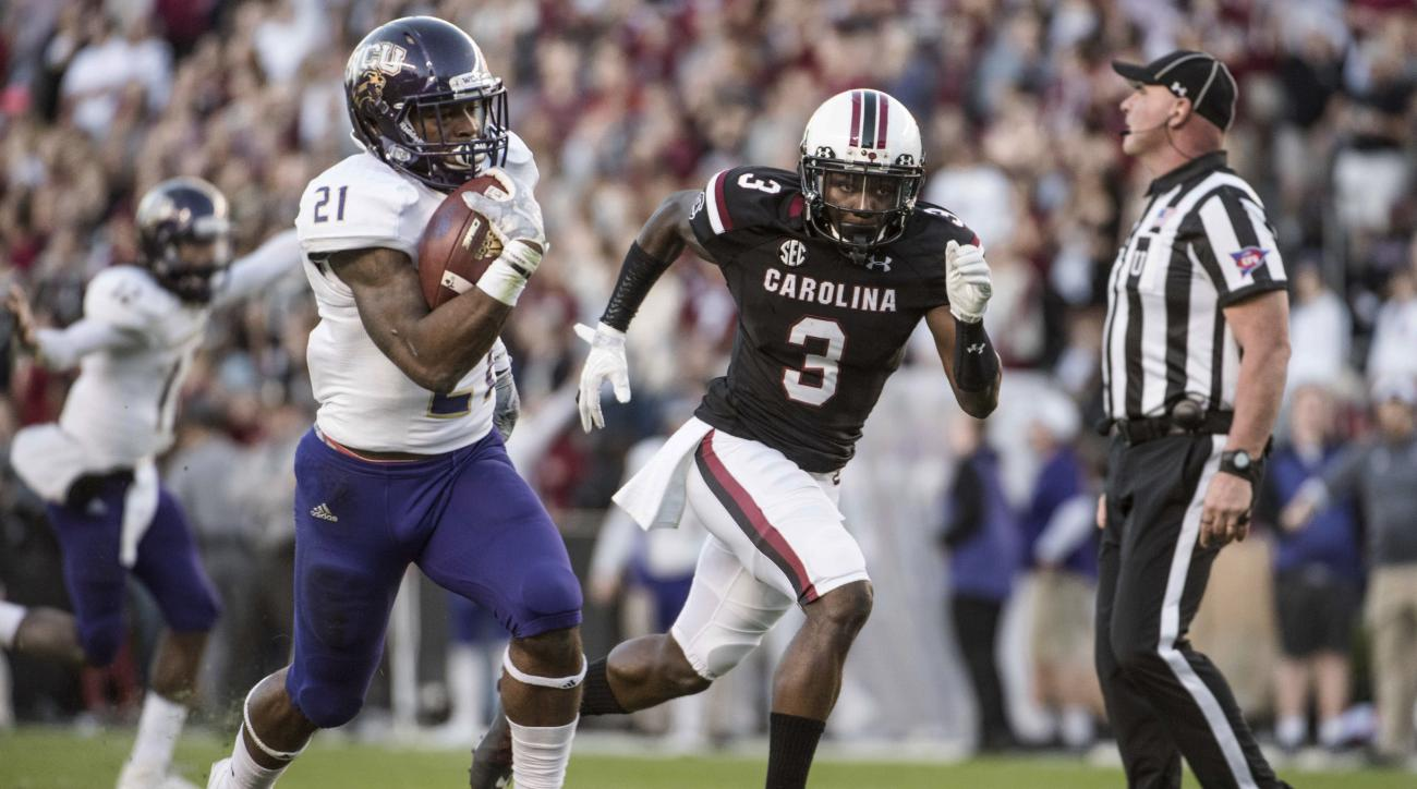 Western Carolina running back Detrez Newsome (21) runs the ball against South Carolina defensive back Chris Lammons (3) during the first half of an NCAA college football game Saturday, Nov. 19, 2016, in Columbia, S.C. South Carolina defeated Western Carol