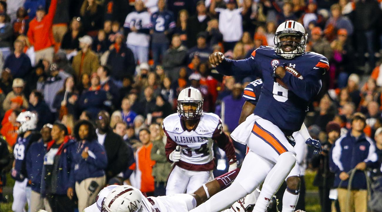 Auburn quarterback Jeremy Johnson (6) carries the ball in for a touchdown against Alabama A&M during the first half of an NCAA college football game Saturday, Nov. 19, 2016, in Auburn, Ala. (AP Photo/Butch Dill)