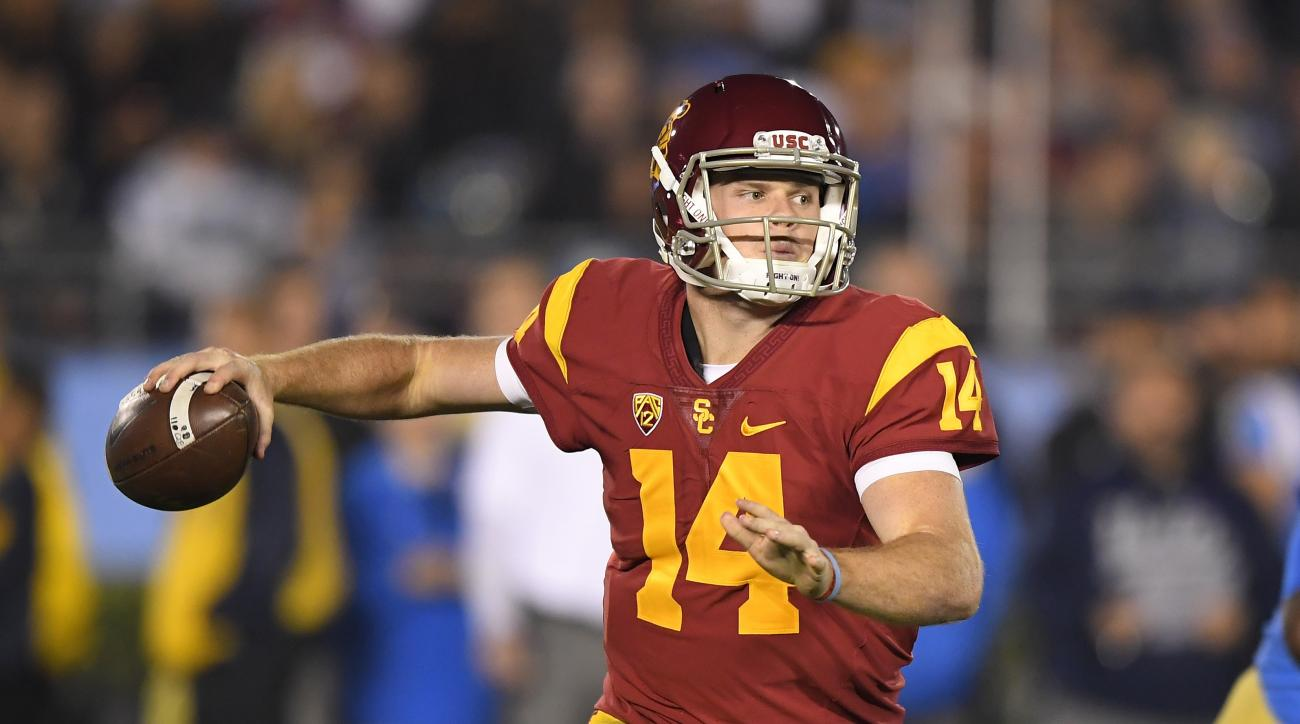 Southern California quarterback Sam Darnold passes during the first half of an NCAA college football game against UCLA, Saturday, Nov. 19, 2016, in Pasadena, Calif. (AP Photo/Mark J. Terrill)