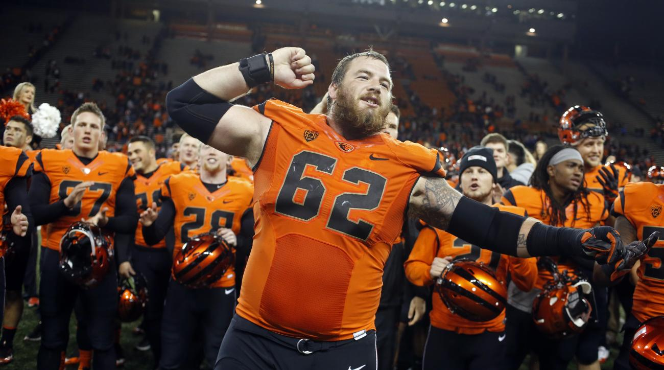 Oregon State offensive guard Gavin Andrews (62) leads the Beavers in singing the fight song after the team's 42-17 win over Arizona in an NCAA college football game in Corvallis, Ore., Saturday Nov. 19, 2016. (AP Photo/Timothy J. Gonzalez)