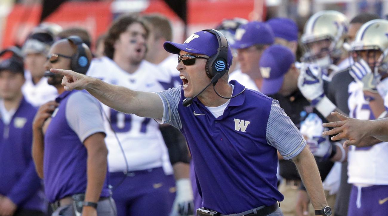 FILE - In this Oct. 29, 2016, file photo, Washington head coach Chris Petersen shouts to his team in the second half of an NCAA college football game against Utah, in Salt Lake City. For Washington's Chris Petersen, college football's most unassuming star