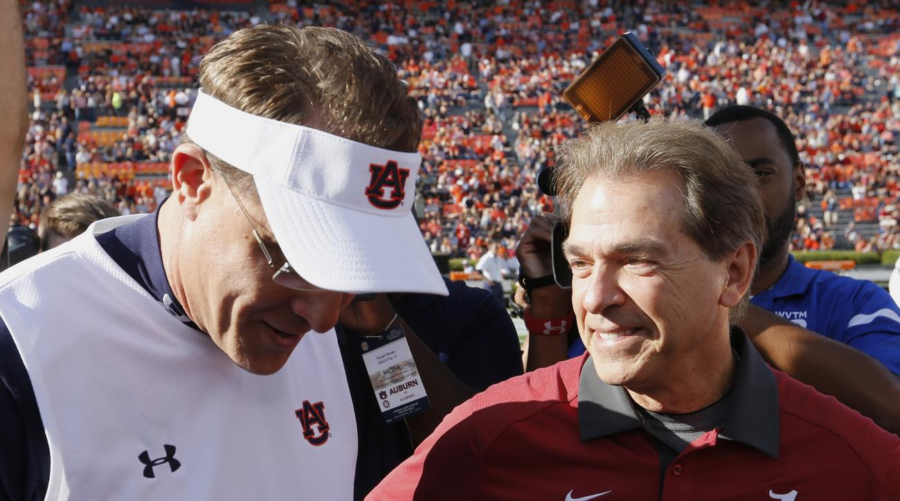 FILE - In this Nov. 28, 2015, file photo, Alabama head coach Nick Saban, right, and Auburn head coach Gus Malzahn meet before an NCAA college football game in Auburn, Ala. The top-ranked Crimson Tide and No. 16 Auburn meet Saturday in The Iron Bowl. (AP P