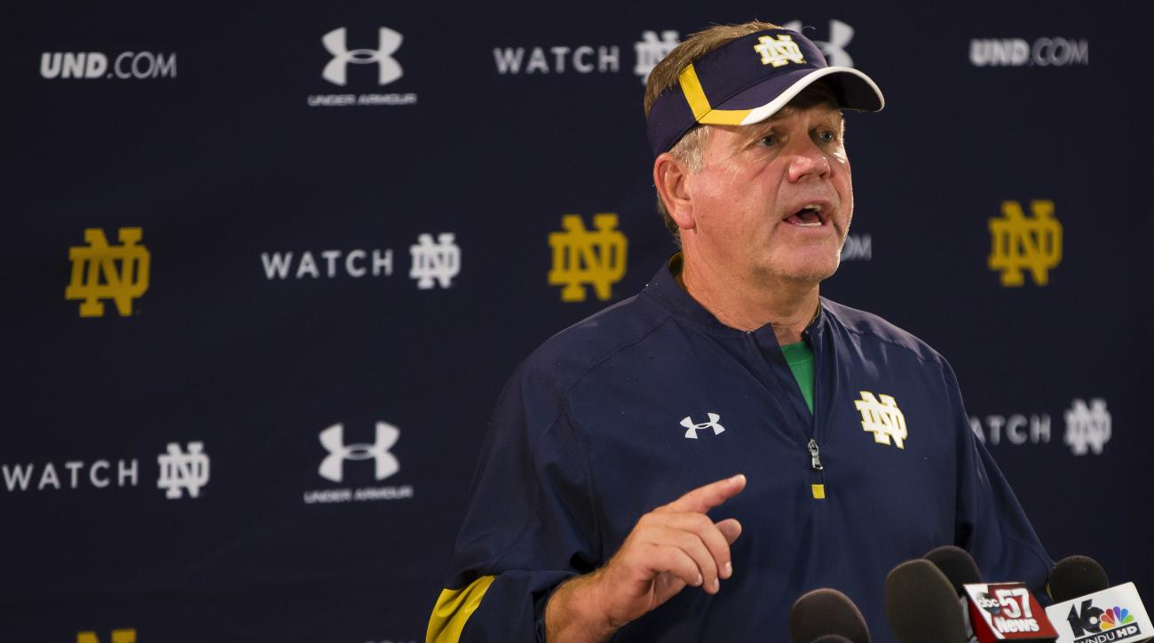 FILE - In this Aug. 24, 2016, file photo, Notre Dame NCAA college football coach Brian Kelly speaks during a news conference in South Bend, Ind.  The NCAA is calling for Notre Dame to vacate victories from 2012 and 2013 football seasons because a former s