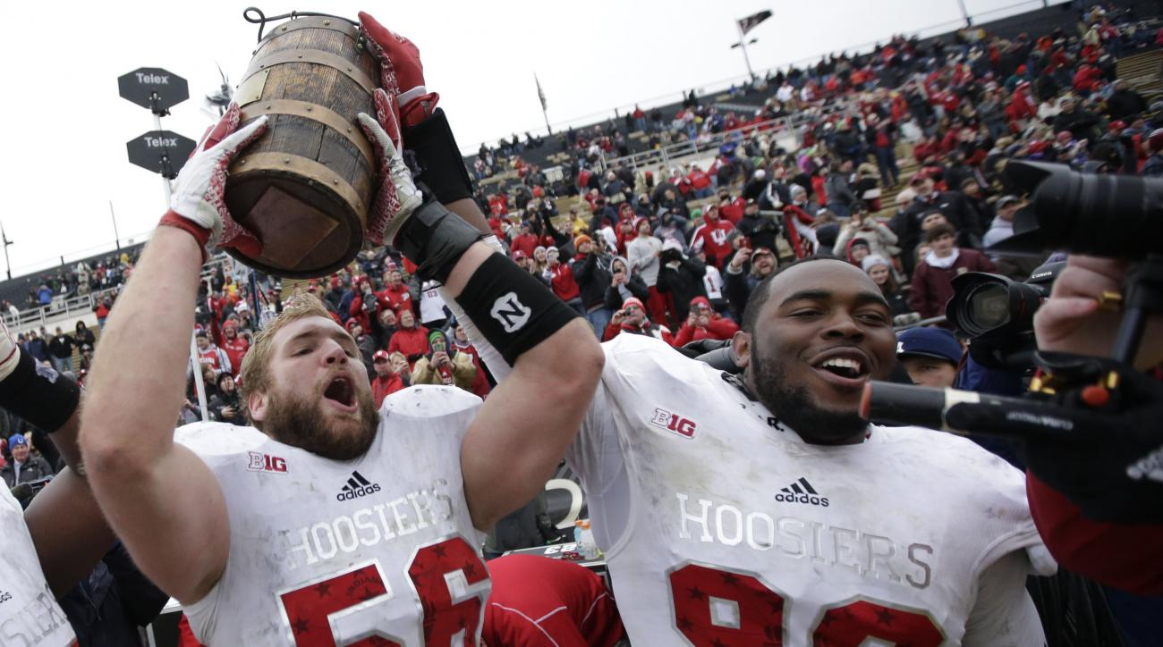 FILE - In this Nov. 28, 2015, file photo, Indiana defensive linemen Nick Mangieri (56) and Adarius Rayner (99) celebrate with the Old Oaken Bucket after defeating Purdue in an NCAA college football game in West Lafayette, Ind. Big Ten teams have been play