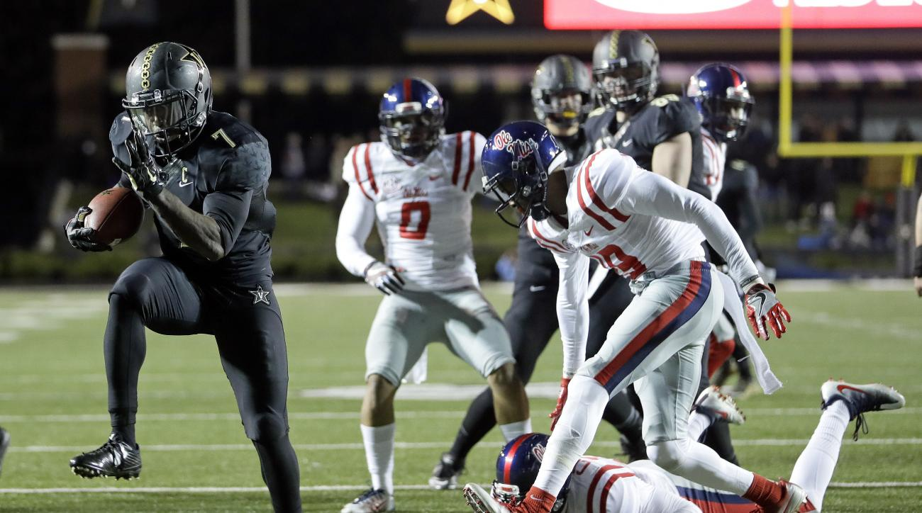 FILE - In this Nov. 19, 2016, file photo, Vanderbilt running back Ralph Webb (7) scores a touchdown against Mississippi on an 11-yard run in the second half of an NCAA college football game, in Nashville, Tenn. Vanderbilt won 38-17. The Commodores have a