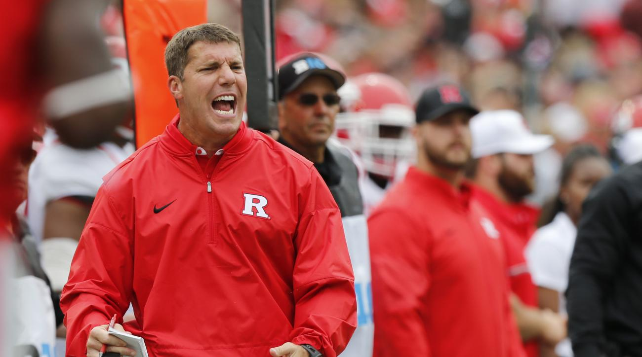 FILE - In this Saturday, Oct. 1, 2016 file photo, Rutgers head coach Chris Ash shouts to his team during the first half of an NCAA college football game against Ohio State in Columbus, Ohio. Rutgers plays Maryland on Saturday, Nov. 26, 2016. (AP Photo/Jay