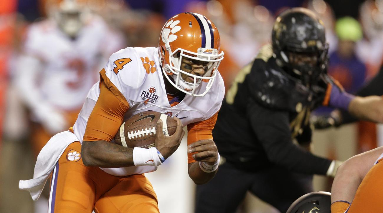 FILE -  In this Saturday, Nov. 19, 2016 file photo, Clemson's Deshaun Watson (4) runs against Wake Forest during the second half of an NCAA college football game in Winston-Salem, N.C. The ACC has won seven of eight games against in-state SEC teams on Riv