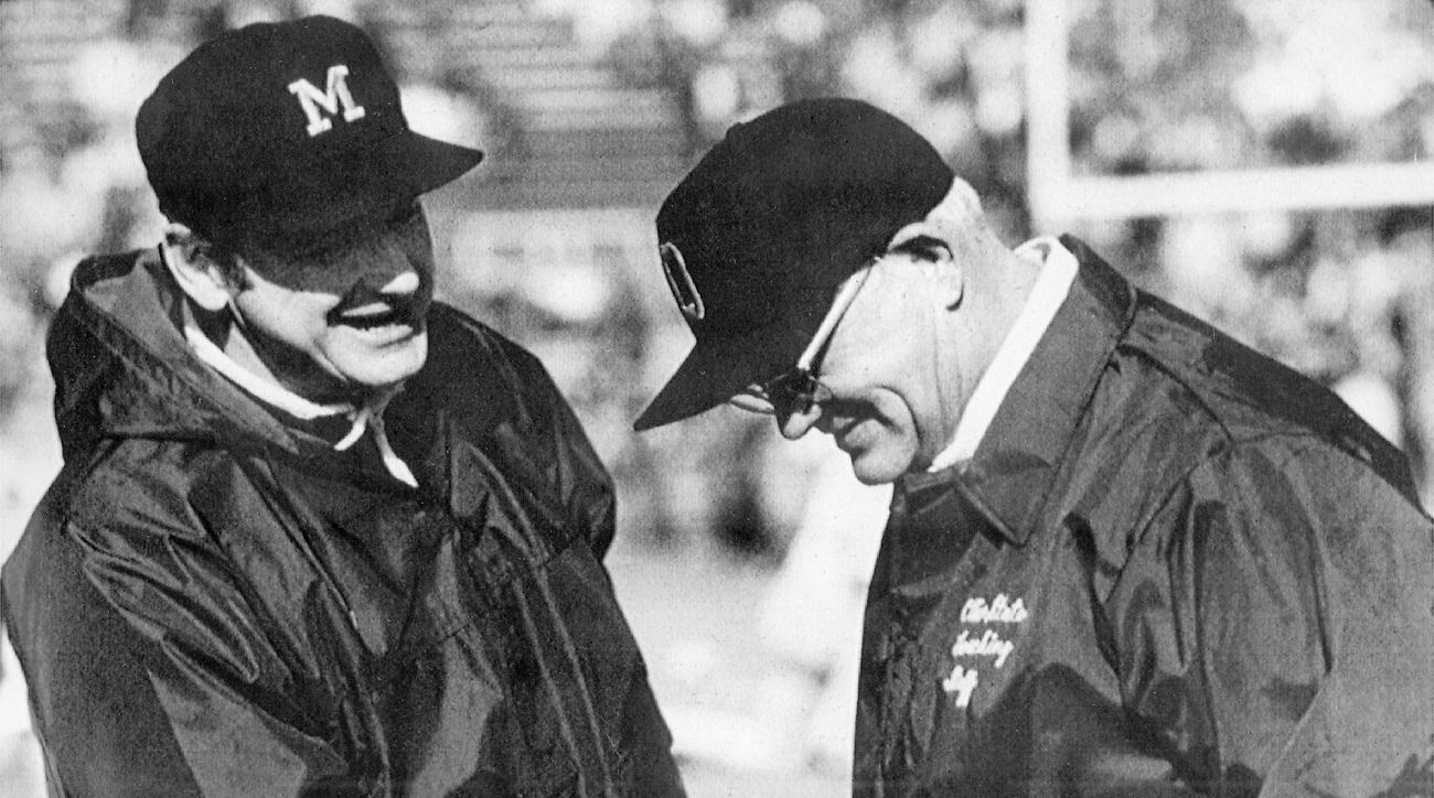 FILE - In this file photo, date and location not known, Michigan coach Bo Schembechler, left, meets with Ohio State coach Woody Hayes before an NCAA college football game. The story of the Ohio State-Michigan rivalry will always best be told through the t