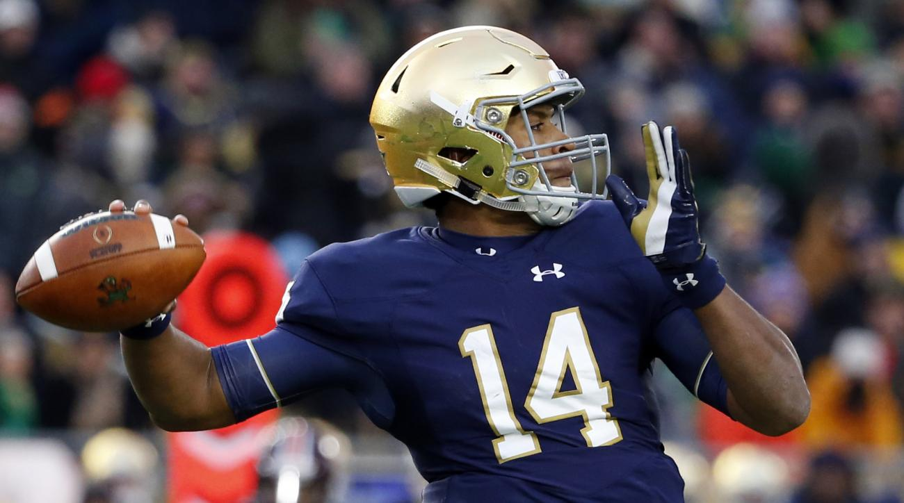 FILE - In this Nov. 19, 2016, file photo, Notre Dame quarterback DeShone Kizer looks to pass against Virginia Tech during the first half of an NCAA college football game in South Bend, Ind. Kizer says Notre Dame players are remembering the pain they felt