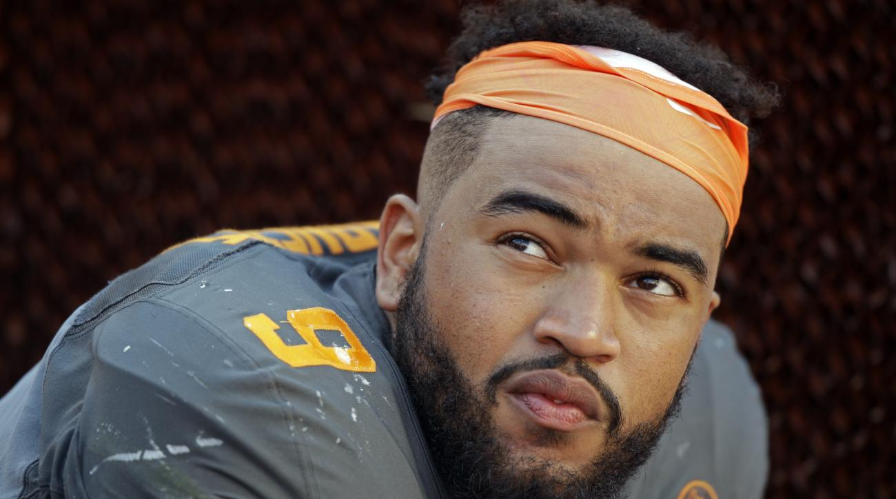 FILE - In this Sept. 24, 2016, file photo, Tennessee defensive end Derek Barnett (9) watches from the sideline during the second half of an NCAA college football game against Florida, in Knoxville, Tenn. Barnett returns to his hometown with a chance to pa