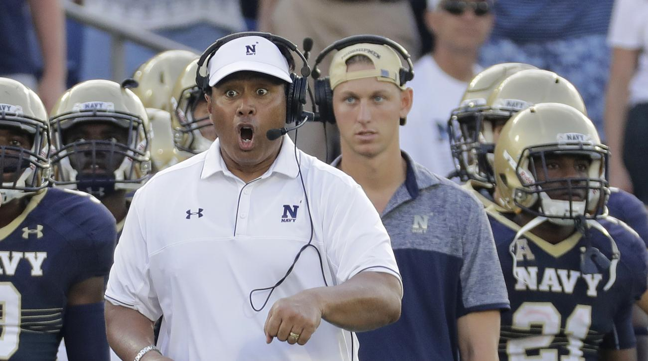 FILE - In this Sept. 10, 2016, file photo, Navy head coach Ken Niumatalolo directs his players from the sideline in the second half of an NCAA college football game against Connecticut, in Annapolis, Md. Navy could still play the American Athletic Confere