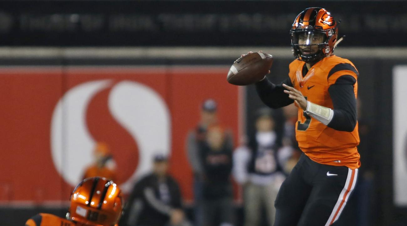 FILE--In this Nov. 19, 2016, file photo, Oregon State quarterback Marcus McMaryion looks to throw in the first half of an NCAA college football game in Corvallis, Ore. Even though there aren't any conference championships or bowl games on the line, the wi
