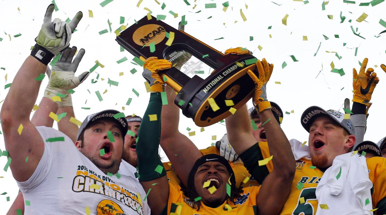 North Dakota State players celebrates with the trophy after they defeated Jacksonville State 37-10 in the FCS championship NCAA college football game, Saturday, Jan. 9, 2016, in Frisco, Texas.  (AP Photo/Mike Stone)