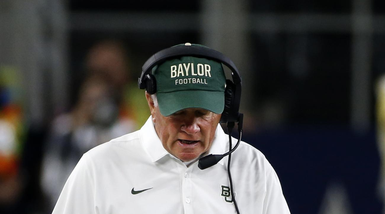 Baylor head coach Jim Grobe walks the sideline during the second half of an NCAA college football game against Texas Tech, Friday, Nov. 25, 2016, in Arlington, Texas. (AP Photo/Ron Jenkins)