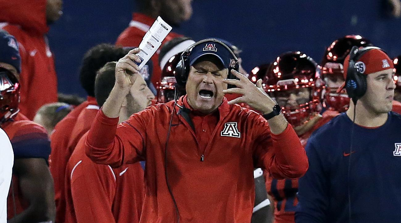 Arizona coach Rich Rodriguez reacts after a penalty during the second half of the teams NCAA college football game against Arizona State, Friday, Nov. 25, 2016, in Tucson, Ariz. Arizona defeated Arizona State 56-35. (AP Photo/Rick Scuteri)