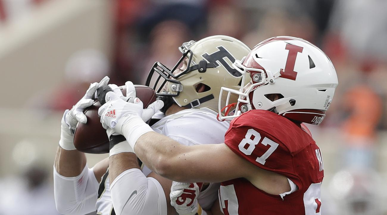 Purdue's Markus Bailey (21) intercepts a pass intended by Indiana's Mitchell Paige (87) during the first half of an NCAA college football game Saturday, Nov. 26, 2016, in Bloomington, Ind. (AP Photo/Darron Cummings)