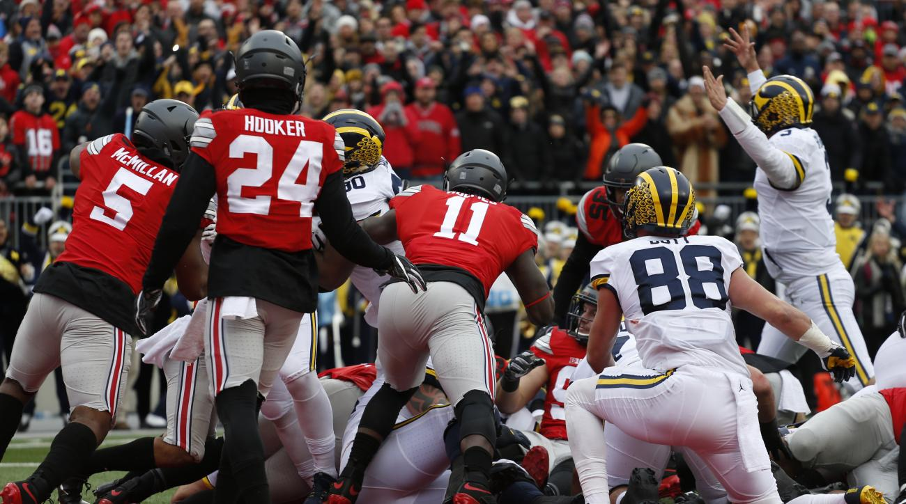 Michigan quarterback Wilton Speith, right, signals a touchdown against Ohio State during the first half of an NCAA college football game Saturday, Nov. 26, 2016, in Columbus, Ohio. (AP Photo/Jay LaPrete)