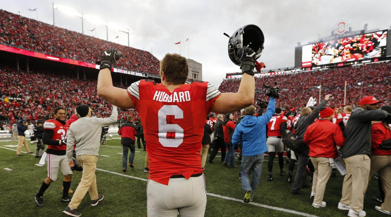 Ohio State defensive end Sam Hubbard celebrates their win over Michigan in an NCAA college football game Saturday, Nov. 26, 2016, in Columbus, Ohio. Ohio State beat Michigan 30-27 in double overtime. (AP Photo/Jay LaPrete)