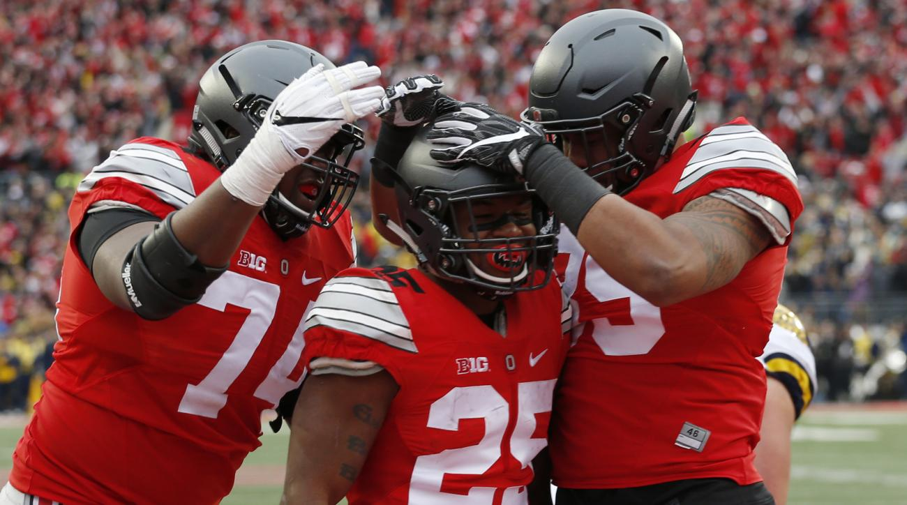 Ohio State running back Mike Weber, center, celebrates his touchdown against Michigan with teammates Jamarco Jones, left, and Luke Farrell during the second half of an NCAA college football game Saturday, Nov. 26, 2016, in Columbus, Ohio. Ohio State beat
