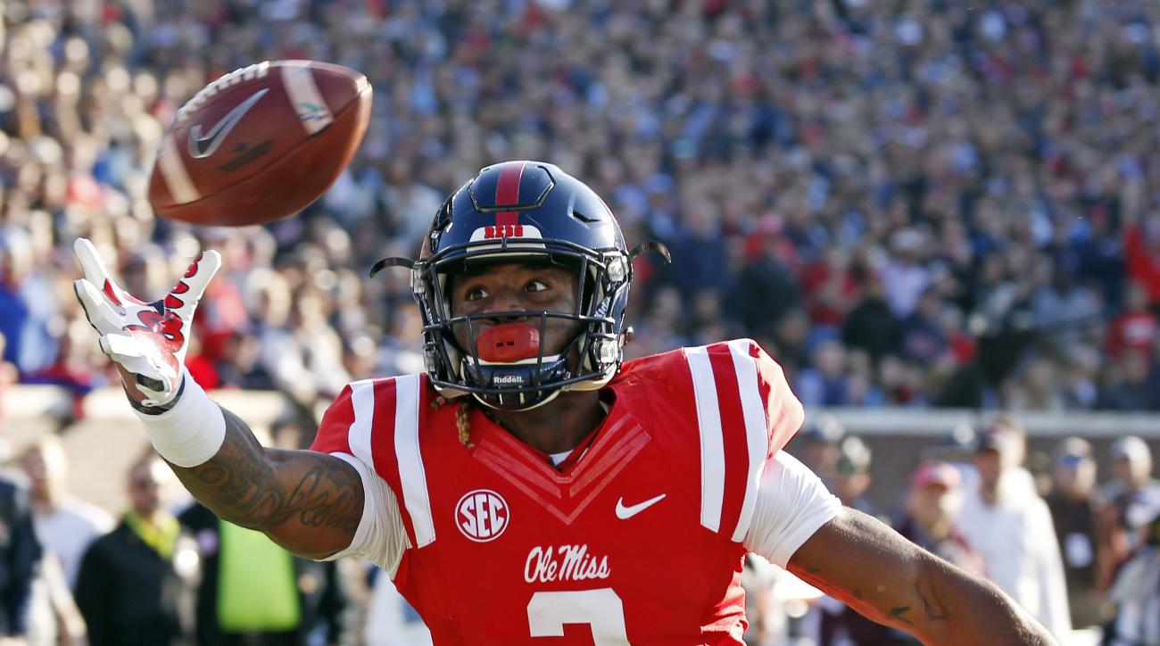 Mississippi wide receiver Damore'ea Stringfellow (3) stretches for an overthrown pass against Mississippi State in the first half of an NCAA college football game in Oxford, Miss., Saturday, Nov. 26, 2016. Stringfellow did not catch the ball. (AP Photo/Ro