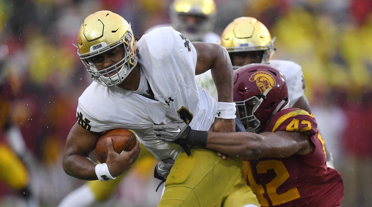 Notre Dame quarterback DeShone Kizer, left, is sacked by Southern California linebacker Uchenna Nwosu during the first half of an NCAA college football game, Saturday, Nov. 26, 2016, in Los Angeles. (AP Photo/Mark J. Terrill)