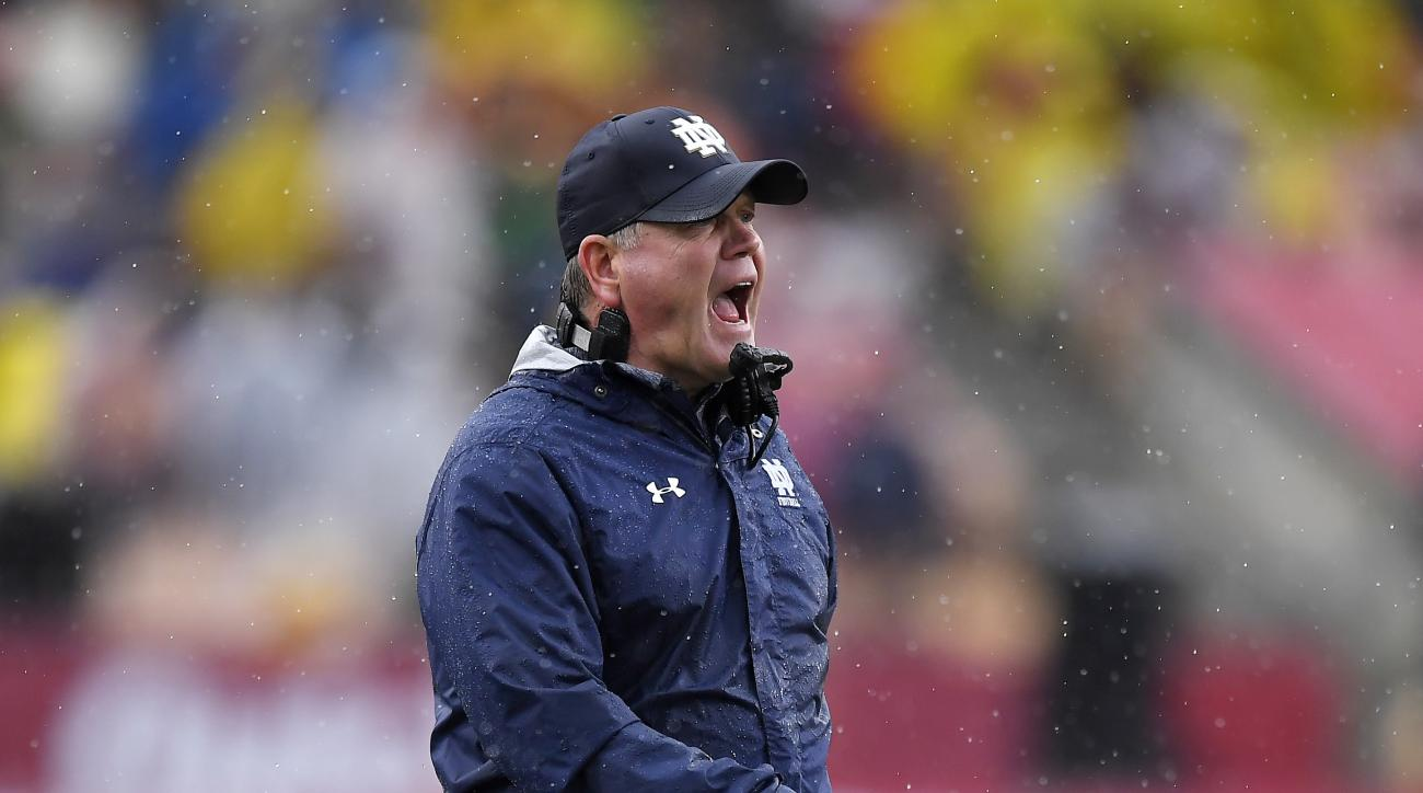Notre Dame head coach Brian Kelly yells to his team during the first half of an NCAA college football game against Southern California, Saturday, Nov. 26, 2016, in Los Angeles. (AP Photo/Mark J. Terrill)