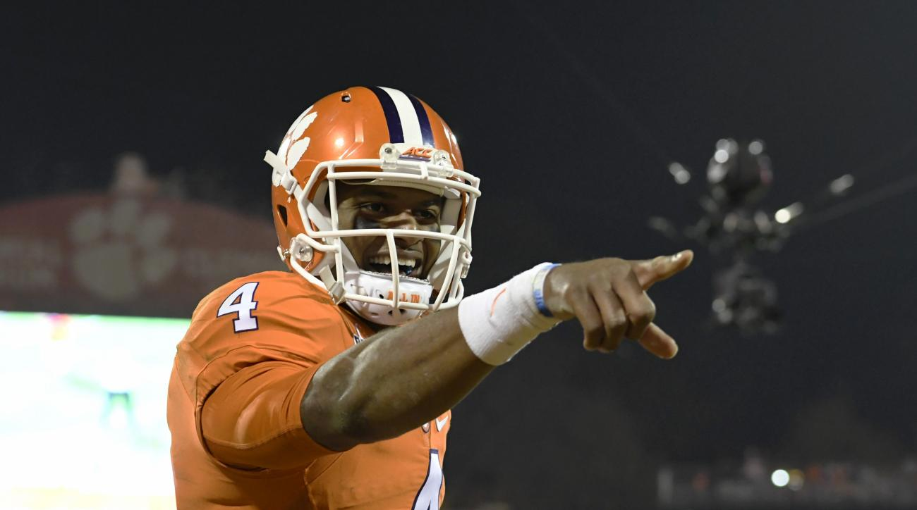 Clemson quarterback Deshaun Watson reacts after throwing a touchdown pass to Artavis Scott during the second half of an NCAA college football game against South Carolina Saturday, Nov. 26, 2016, in Clemson, S.C. (AP Photo/Richard Shiro)