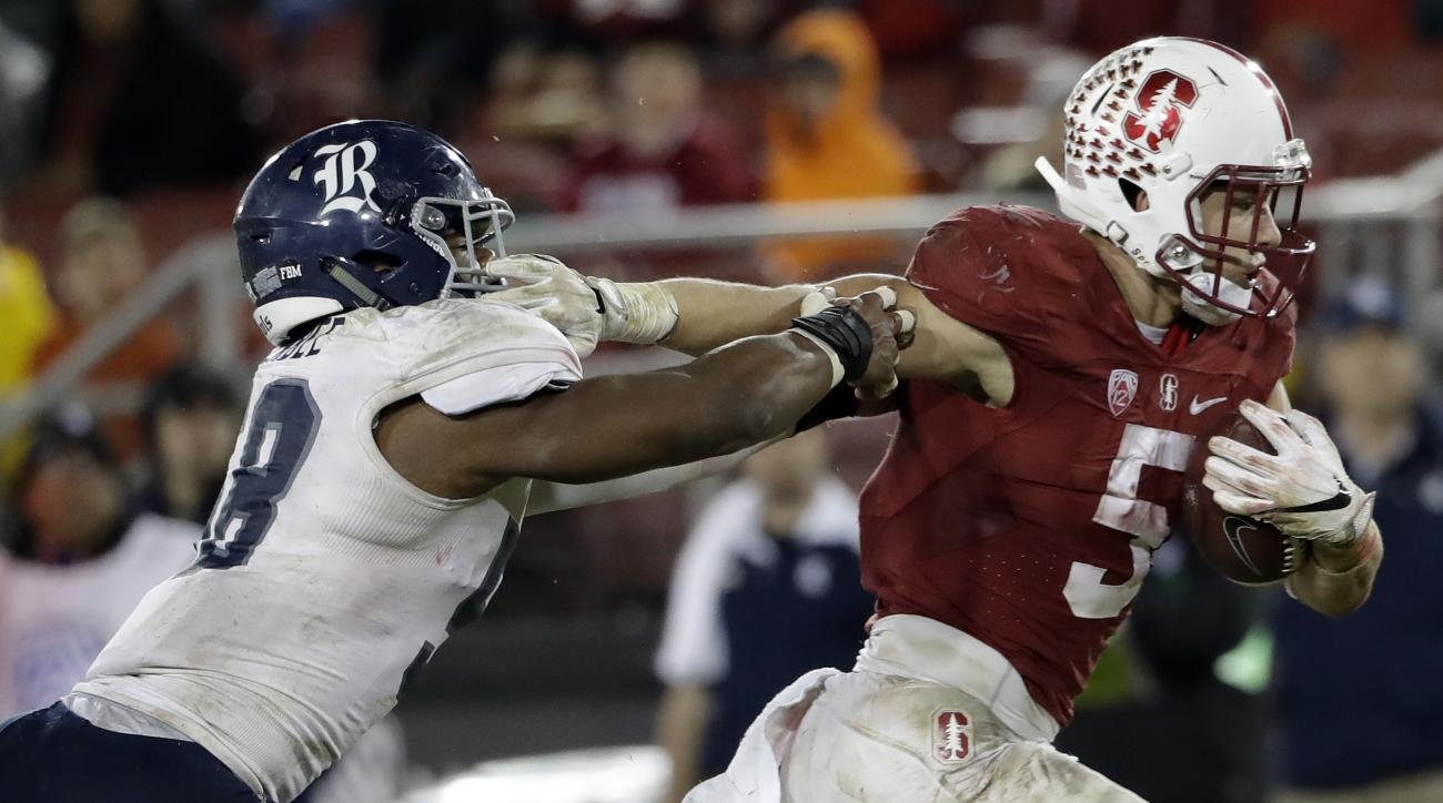 Stanford running back Christian McCaffrey, right, runs past Rice linebacker Emmanuel Ellerbee on rushing touchdown during the second half of an NCAA college football game Saturday, Nov. 26, 2016, in Stanford, Calif. (AP Photo/Marcio Jose Sanchez)