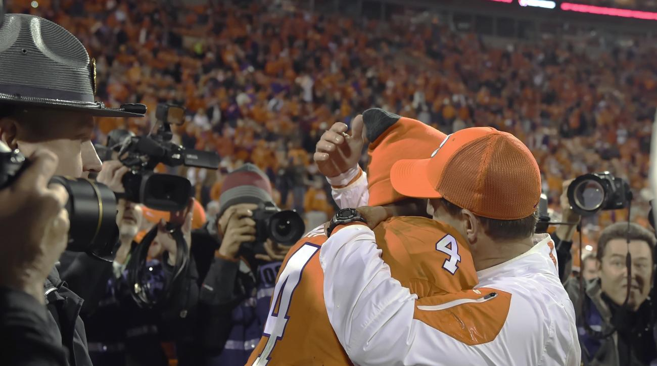 Clemson head coach Dabo Swinney hugs Deshaun Watson after an NCAA college football game against South Carolina Saturday, Nov. 26, 2016, in Clemson, S.C. Clemson won 56-7. (AP Photo/Richard Shiro)