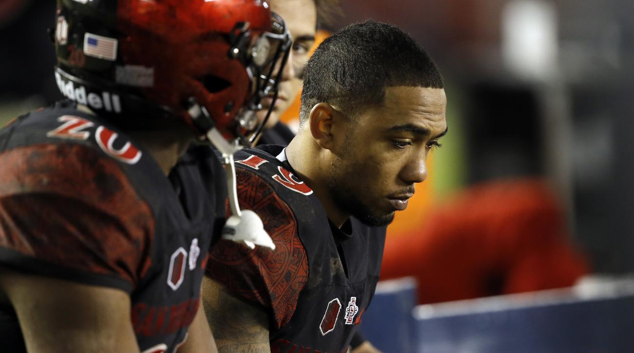 San Diego State running back Donnel Pumphrey, right, and teammates sit on the bench during the second half of an NCAA football game against Colorado State in San Diego, Saturday, Nov. 26, 2016. Pumphrey had 18 carries for 53 yards. Colorado State won 63-3