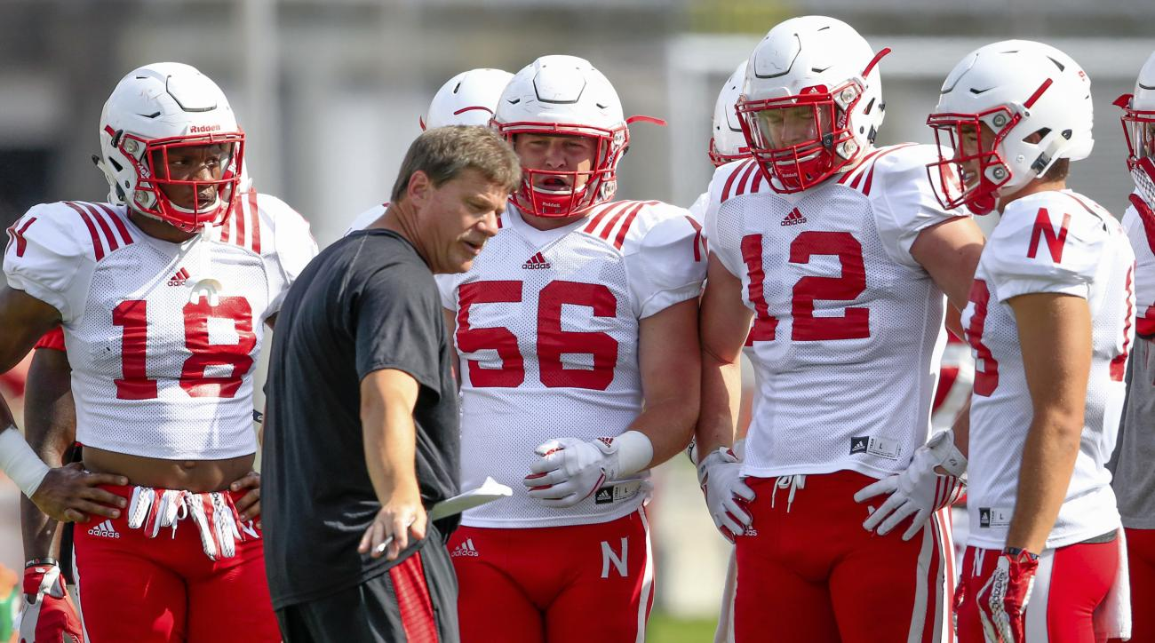 In this Aug. 23, 2016 file photo, Nebraska linebacker Brad Simpson (56) stands between Tre Bryant (18) and Luke Gifford (12) as they listen to special teams coordinator Bruce Read, during NCAA college football practice in Lincoln, Neb. On Sunday, Nov. 27,
