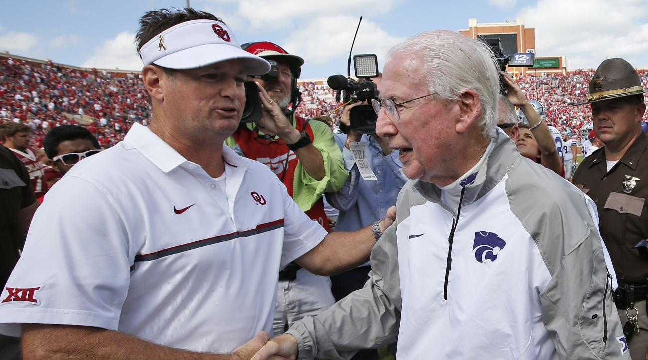 FILE - In this Oct. 15, 2016, file photo, Oklahoma head coach Bob Stoops, left, shakes hands with Kansas State head coach Bill Snyder following their NCAA college football game in Norman, Okla. Bob Stoops was a young defensive assistant when he joined the