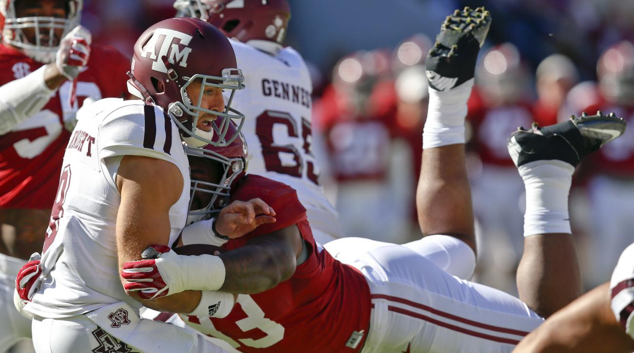FILE - In this Oct. 22, 2016, file photo, Alabama defensive lineman Jonathan Allen (93) sacks Texas A&M quarterback Trevor Knight during the first half of an NCAA college football game,in Tuscaloosa, Ala. The Southeastern Conference's two stingiest defens