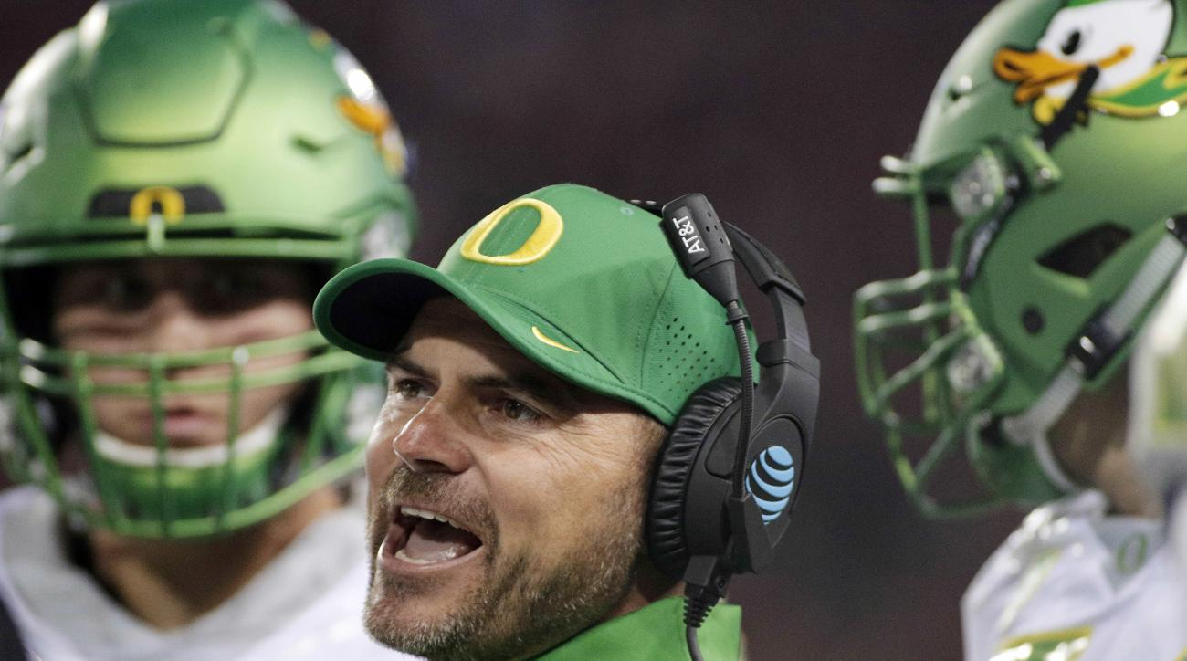 FILE - In this Oct. 1, 2016, file photo, Oregon head coach Mark Helfrich instructs his team during the first half of an NCAA college football game in Pullman, Wash. Oregon fired coach Helfrich Tuesday night, Nov. 29, 2016, after a disappointing 4-8 season