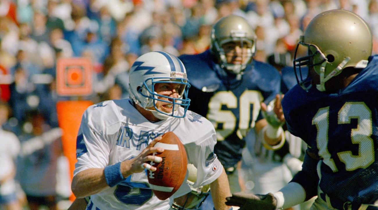 FILE - In this Oct. 7, 1989, file photo, Air Force quarterback Dee Dowis looks for running room against the defense of Naval Academy defensive back Rodney Brown during a college football game at Memorial Stadium in Annapolis, Md. Dowis, who finished sixth