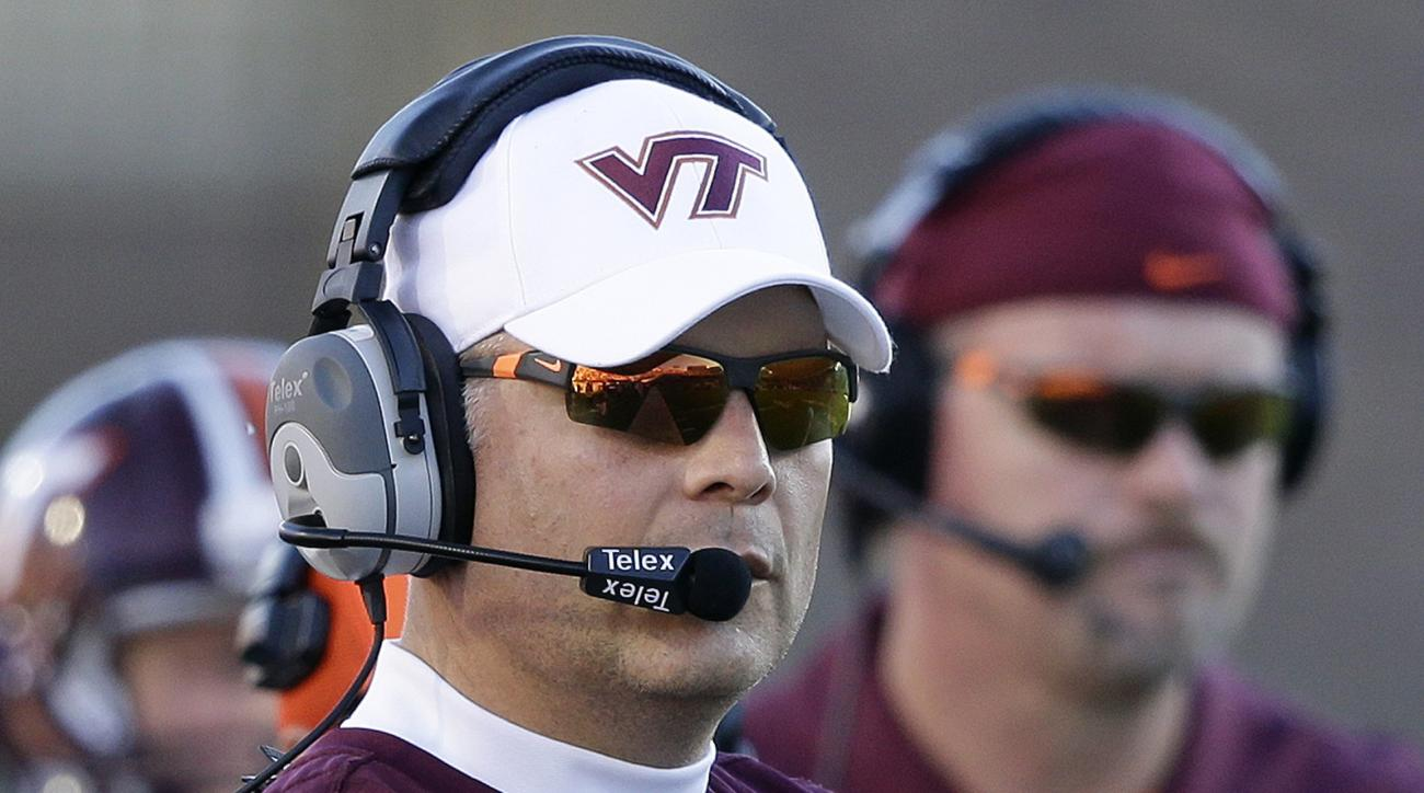 FILE - In this Nov. 5, 2016, file photo, Virginia Tech head coach Justin Fuente watches from the sideline during the first half of an NCAA college football game against Duke,  in Durham, N.C. Clemson's Dabo Swinney and Virginia Tech's Justin Fuente will b