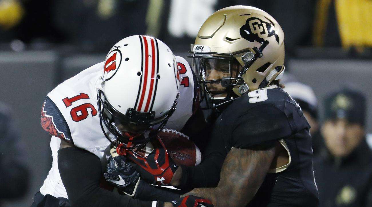 In this Saturday, Nov. 26, 2016, photograph, Colorado defensive back Tedric Thompson, right, tackles Utah wide receiver Cory Butler-Byrd after maing a catch for a long gain in the second half of an NCAA college football game in Boulder, Colo. Two years af